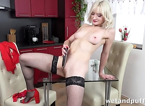 Sexy blonde with reference to stockings pleases in the flesh with dildo
